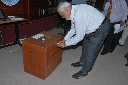Dr B K Saxena Election Offcier Opening The Ballot Box 1000